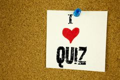 Hand writing text caption inspiration showing I Love Quiz concept meaning Test education Exam Concept Loving written on sticky not. E, reminder isolated royalty free stock photo