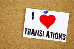 Hand writing text caption inspiration showing I Love Translations concept meaning  Translate Explain Plead Book Language Loving wr. Itten on sticky note Royalty Free Stock Image