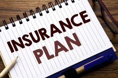 Hand writing text caption inspiration showing Insurance Plan. Business concept for Health Life Insured Written on notebook note pa. Hand writing text caption Stock Photos