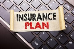Hand writing text caption inspiration showing Insurance Plan. Business concept for Health Life Insured written on sticky note pape. R on dark keyboard background Stock Photography
