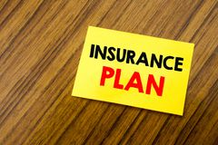Hand writing text caption inspiration showing Insurance Plan. Business concept for Health Life Insured written on sticky note pape. R on wooden keyboard Royalty Free Stock Image