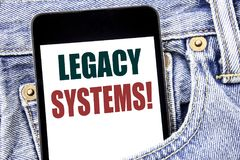 Hand writing text caption inspiration showing Legacy Systems. Business concept for Upgrade SOA Application written on smartphone i. N jeans pants. Blue Royalty Free Stock Images