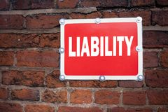 Hand writing text caption inspiration showing Liability concept meaning Accountability Legal Blame Risk written on old announcemen Royalty Free Stock Images