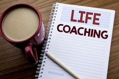 Hand writing text caption inspiration showing Life Coaching. Business concept for Personal Coach Help written on note paper notepa. D on the wooden background Stock Images