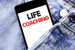 Hand writing text caption inspiration showing Life Coaching. Business concept for Personal Coach Help Written phone mobile phone,. Cellphone placed in man front Royalty Free Stock Images