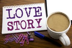 Hand writing text caption inspiration showing Love Story. Business concept for Loving Someone Heart  written on note paper on the. Hand writing text caption Stock Photos