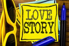Hand writing text caption inspiration showing Love Story. Business concept for Loving Someone Heart  Written on sticky note paper,. Wooden background vacation Royalty Free Stock Image