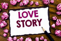 Hand writing text caption inspiration showing Love Story. Business concept for Loving Someone Heart  Written on sticky note paper,. Wooden background folded Royalty Free Stock Images