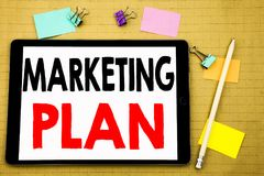 Hand writing text caption inspiration showing Marketing Plan. Business concept for Planning Successful Strategy Written on tablet. Wooden background with Stock Photo