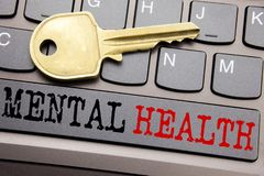Hand writing text caption inspiration showing Mental Health. Business concept for Anxiety Illness Disorder written on keyboard key. On the key next to the text royalty free stock photos