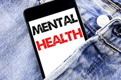 Hand writing text caption inspiration showing Mental Health. Business concept for Anxiety Illness Disorder Written phone mobile ph. One, cellphone placed in man stock photography