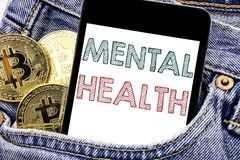 Hand writing text caption inspiration showing Mental Health. Business concept for Anxiety Illness Disorder Written phone mobile ph. One, cellphone placed in man royalty free stock images