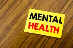 Hand writing text caption inspiration showing Mental Health. Business concept for Anxiety Illness Disorder written on sticky note. Paper on wooden keyboard stock images