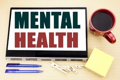 Hand writing text caption inspiration showing Mental Health. Business concept for Anxiety Illness Disorder written on tablet lapto. P. Office place with coffee stock photo