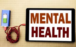 Hand writing text caption inspiration showing Mental Health. Business concept for Anxiety Illness Disorder written on tablet lapto. P with white textured stock images