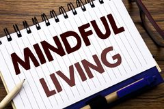 Hand writing text caption inspiration showing Mindful Living. Business concept for Life Happy Awareness Written on notebook note p. Hand writing text caption Stock Images