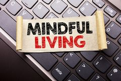 Hand writing text caption inspiration showing Mindful Living. Business concept for Life Happy Awareness written on sticky note pap. Er on dark keyboard Stock Photos