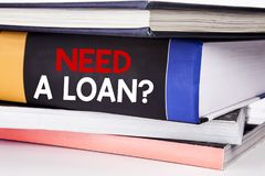 Hand writing text caption inspiration showing Need A Loan Question. Business concept for Mortage Credit written on the book on the. Hand writing text caption Royalty Free Stock Image