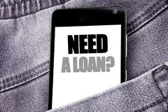 Hand writing text caption inspiration showing Need A Loan Question. Business concept for Mortage Credit written mobile cell phone. With space in the back pants Royalty Free Stock Photos