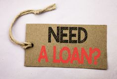 Hand writing text caption inspiration showing Need A Loan Question. Business concept for Mortage Credit written on price tag paper. On white vintage background Royalty Free Stock Photos