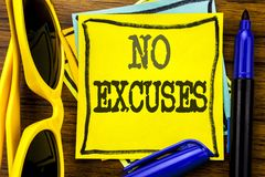 Hand writing text caption inspiration showing No Excuses. Business concept for Stop Ban for Excuse Written on sticky note paper, w. Ooden background vacation Royalty Free Stock Photo