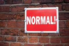 Hand writing text caption inspiration showing Normal concept meaning Confidence Abnormal Normality Problem Issue written on old an. Nouncement road sign with Royalty Free Stock Image