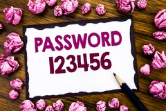 Hand writing text caption inspiration showing Password 123456. Business concept for Security Internet Written on sticky note paper stock photo