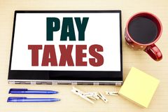 Hand writing text caption inspiration showing Pay Taxes. Business concept for Taxation Overtax Return written on tablet laptop. Of. Hand writing text caption Stock Images
