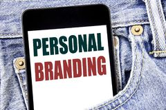 Hand writing text caption inspiration showing Personal Branding. Business concept for Brand Building written on smartphone in the. Hand writing text caption stock image