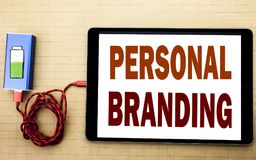 Hand writing text caption inspiration showing Personal Branding. Business concept for Brand Building written on tablet laptop with. White textured background royalty free stock images