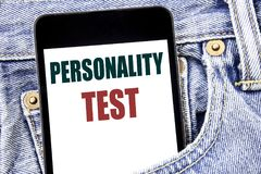 Hand writing text caption inspiration showing Personality Test. Business concept for Attitude Assessment written on smartphone in. Jeans pants. Blue background stock photos
