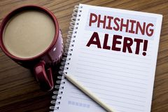 Hand writing text caption inspiration showing Phishing Alert. Business concept for Fraud Warning Danger written on note paper note. Pad on the wooden background Royalty Free Stock Image