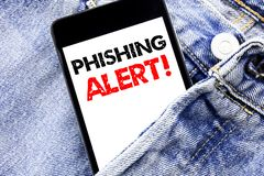 Hand writing text caption inspiration showing Phishing Alert. Business concept for Fraud Warning Danger Written phone mobile phone. Cellphone placed in man Stock Photos