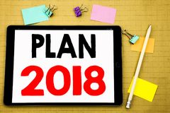 Hand writing text caption inspiration showing Plan 2018. Business concept for Planning Strategy Action Plan Written on tablet lapt. Hand writing text caption Royalty Free Stock Images