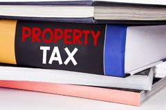 Hand writing text caption inspiration showing Property Tax. Business concept for Estate Income Taxation written on the book on the. Hand writing text caption stock images
