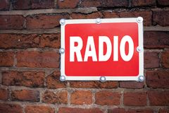 Hand writing text caption inspiration showing Radio concept meaning Media and Education written on old announcement road sign with. Background and space Royalty Free Stock Images