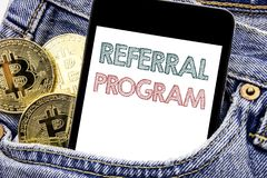 Hand writing text caption inspiration showing Referral Program. Business concept for Refer Marketing  Written phone mobile phone,. Cellphone placed in man front Royalty Free Stock Photography