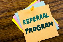 Hand writing text caption inspiration showing Referral Program. Business concept for Refer Marketing written on sticky note paper. On wooden background royalty free stock photo