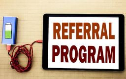 Hand writing text caption inspiration showing Referral Program. Business concept for Refer Marketing written on tablet laptop wit. H white textured background royalty free stock photography