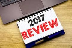 Hand writing text caption inspiration showing 2017 Review. Business concept for Annual Summary Report written on notebook book on. Wooden background in the Stock Photography