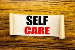 Hand writing text caption inspiration showing Self Care. Business concept for Taking caring for own Health written on sticky note. Paper on wooden background royalty free stock images