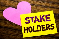 Hand writing text caption inspiration showing Stake Holders. Business concept for Stakeholder Engagement written on sticky note pa royalty free stock images