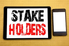 Hand writing text caption inspiration showing Stake Holders. Business concept for Stakeholder Engagement Written on tablet laptop,. Hand writing text caption royalty free stock photo