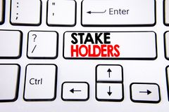 Hand writing text caption inspiration showing Stake Holders. Business concept for Stakeholder Engagement written on white keyboard. Key with copy space. Top royalty free stock photography