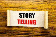Hand writing text caption inspiration showing Storytelling. Business concept for Teller Story Message written on sticky note paper. On wooden background Stock Photo