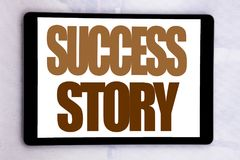 Hand writing text caption inspiration showing Success Story. Business concept for Inspiration Motivation written on tablet screen. On white background Stock Photo
