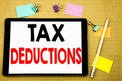 Hand writing text caption inspiration showing Tax Deductions. Business concept for Finance Incoming Tax Money Deduction Written on. Tablet, wooden background Royalty Free Stock Photos