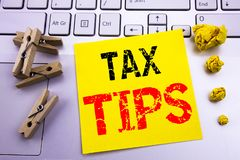 Hand writing text caption inspiration showing Tax Tips. Business concept for Taxpayer Assistance Refund Reimbursement written on s. Ticky paper on the white royalty free stock photos