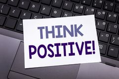 Hand writing text caption inspiration showing Think Positive. Business concept for Positivity Attitude written on sticky note pape. R on black keyboard stock photo