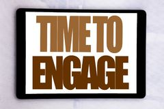 Hand writing text caption inspiration showing Time To Engage. Business concept for Engagement Involvement written on tablet screen. On white background Royalty Free Stock Photo